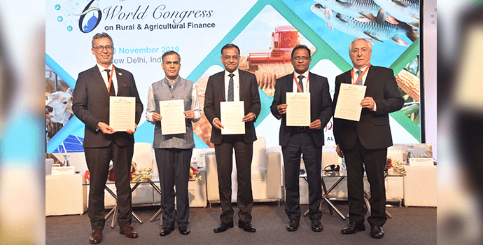 Global leaders with the 'New Delhi Declaration' during the 6th World Congress on Rural and Agricultural Finance